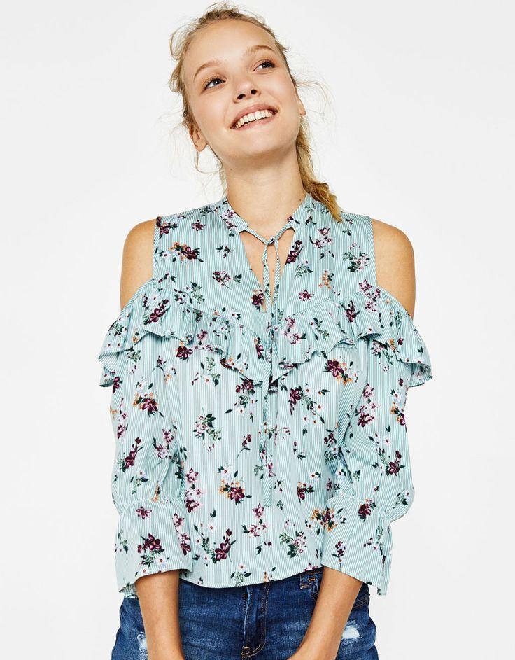 Blusa off shoulder volantes. Descubre ésta y muchas otras prendas en Bershka con nuevos productos cada semana