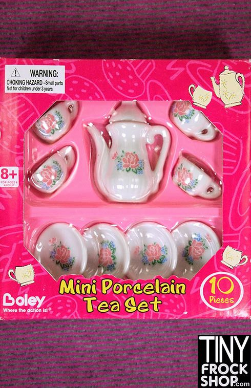 This mini porcelain tea set is so cute!!! White with roses it comes with all you see and is new in box! Package has some wear.