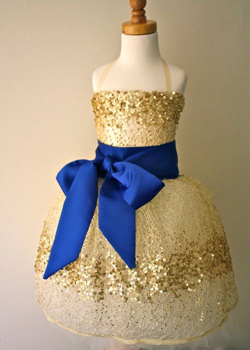 Lea's flower girl dress. Navy blue instead and bow in the back