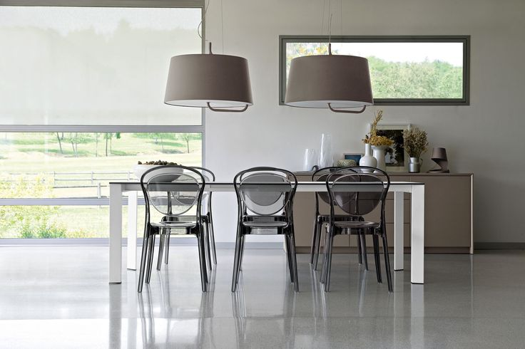 A stunning dining room setting featuring the Calligaris Parisienne Dining Chair.