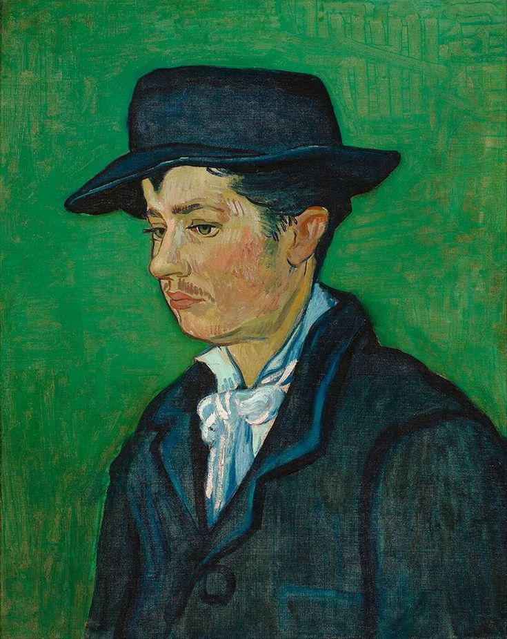 Portrait of Armand Roulin November 1888. He dressed in a dark blue suit and matching hat. Both paintings are very simple in their composition, presenting the young man without any additional details, decoration or scenery such as are provided in the portraits of the Roulin parents or in others where colour, setting or costume attempt to introduce layered meanings. What is remarkable in both these pictures is the seriousness of expression, which is almost sombre and sad.