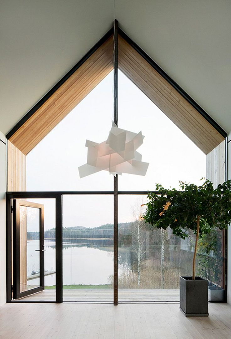 15 Examples Of Homes Where Windows Follow The Roofline // This wall of glass…