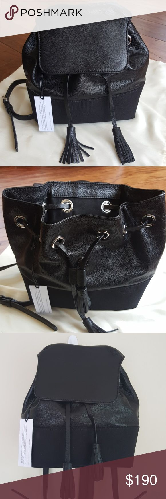 """Rebecca Minkoff """"Mansfield"""" Backpack NWT, mixed media, leather/textile, small but very roomy, drawstring beneath magnetic flap closure, adjustable shoildee straps, straps cam convert from two to one strap usimg zipper detail, interior- double side pockets, zipper pocket and single wall pocket. Measurements: 10'h, 9'w, and 5'd, strap drop 14'. Couple of faint scratches on flap. No dust bag included. Rebecca Minkoff Bags Backpacks"""