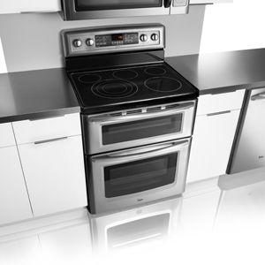 Pretty but I'm not sure that two cheesecake pans can fit in the large oven at the same time - maytag gemini double oven electric range met8885x