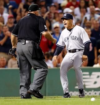 "New York Yankees manger Joe Girardi, right, argues with home plate umpire Brian O'Nora after Alex Rodriguez was hit by a pitch in the second inning of a baseball game in Boston. Girardi saw the replays of Atlanta outfielder Jason Heyward being hit in the face by a pitch that broke his jaw. That's why the Yankees manager was furious at Boston's Ryan Dempster for throwing at Alex Rodriguez a few days earlier. ""It can change a player's life,"" he says."