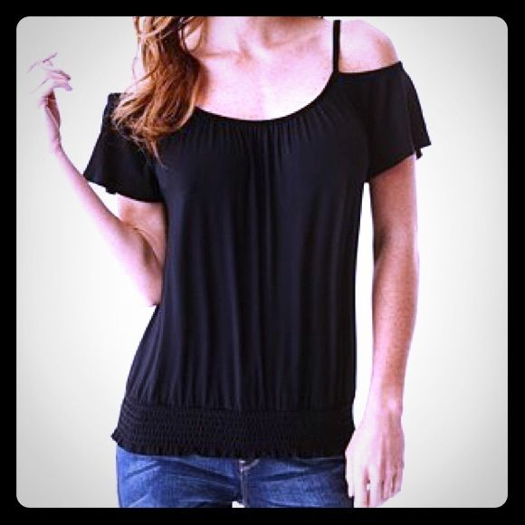 New GUESS Black Smocked Top XS New with tags GUESS Jet Black Smocked Top size XS. Off the shoulder soft knit top. Perfect with skinny jeans. My last one. New with tags! Guess Tops Tunics
