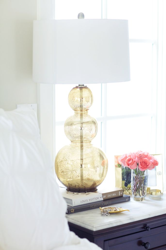 Gold Bedside Lamp And Dark Painted Side Table