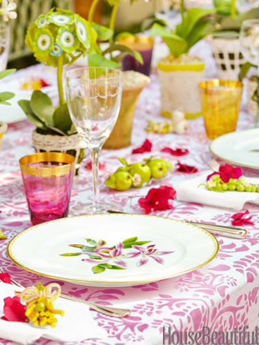 Pretty in pink and green, a combo synonymous with Palm Beach, the table is dressed with china, crystal, flatware, and linens from Mary Mahoney.