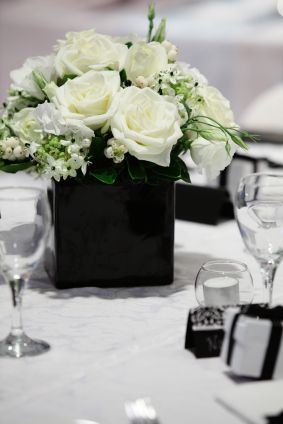 Perfect for a black and white wedding - on a damask runner reception wedding flowers, wedding decor, wedding flower centerpiece, wedding flower arrangement, add pic source on comment and we will update it. www.myfloweraffair.com can create this beautiful wedding flower look.