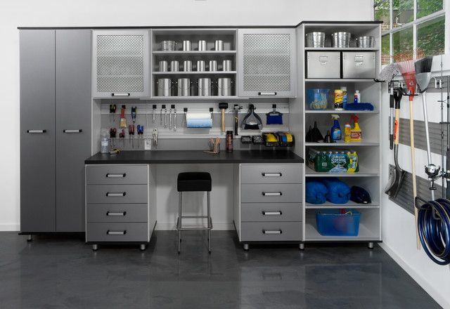Metallic Garage Storage Cabinets Installed Against Wall With Hanging Racks And Open Shelving For Tools