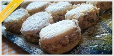 La ricetta delle deliziose napoletane, biscotti tondi farciti di crema al burro e nocciole, ideali da mangiare anche a Natale.