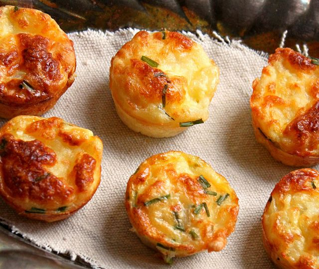 Mini Bisquick Quiches:  Ingredients:  1 cup Bisquick  2 cups milk  4 eggs  Preheat oven to 350.  In a large bowl, mix the Bisquick, milk and eggs together until well combined.   Butter a muffin tin and fill with quiche fillings of choice (ie: diced ham, Swiss cheese, onion...etc)  Cover with the Bisquick Batter.  Bake for about 25 minutes.