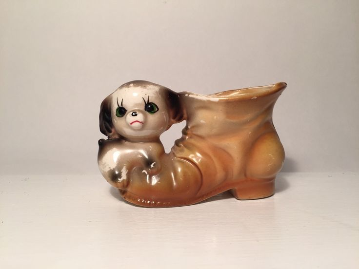 A personal favourite from my Etsy shop https://www.etsy.com/au/listing/280728222/vintage-60s-puppy-dog-on-boot-planter