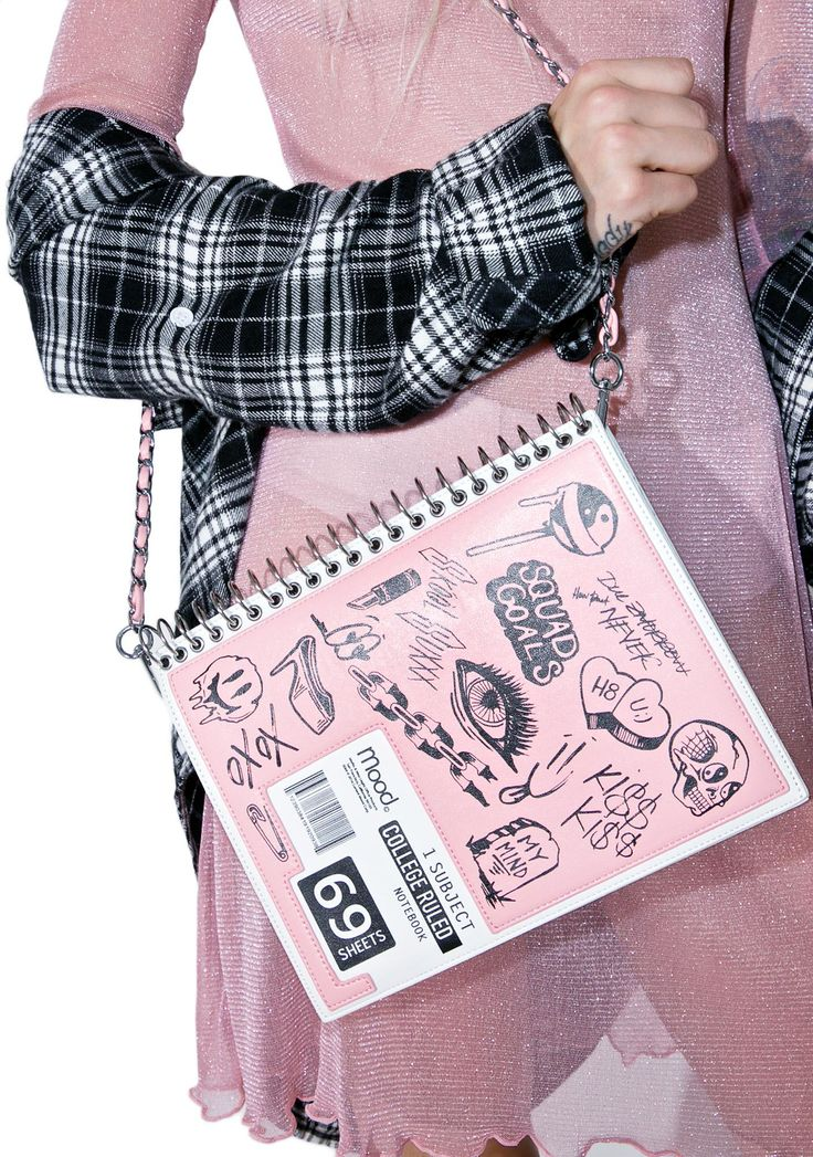 Current Mood Doodle Notebook Bag ...uhmmm, I don't think you wanna borrow my notes, dude. Impress 'em with yer ~creative side~ with this sikk lil shoulder bag, featurin' a sleek pink 'N white vegan leather construction that's made to look like a spiral notebook, silver binding details, magnetic flap top closure, roomy envelope style interior, detachable silver strap, and tonz of unique doodles all ova the front!