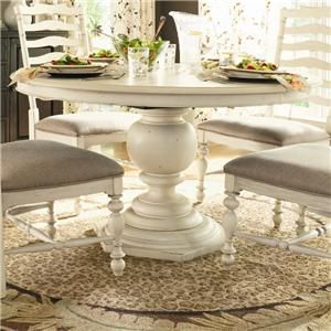 This round pedestal dining table offers the perfect setting for brunch or small dinner parties. The hexagonal base accents the striking look of the turned vase shaped pedestal base. Transform the round table to an oval shape with room for more family and friends with the 18-inch leaf that extends the table to 72 inches long. Complete seating at the Round Pedestal Table with your choice of coordinating side chairs.