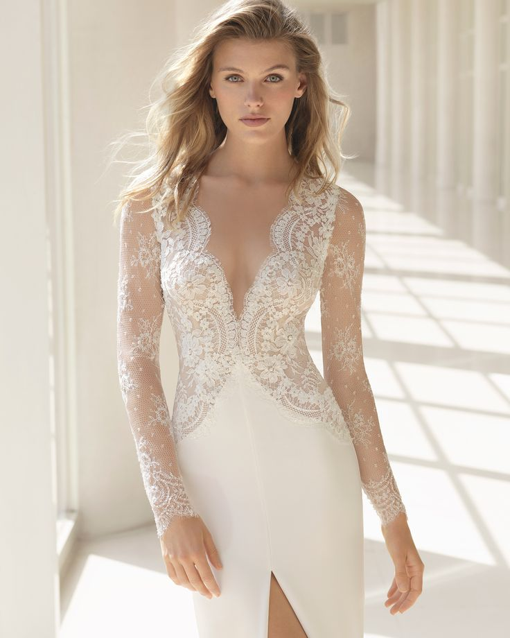 Beaded lace and crepe sheath wedding dress with long sleeves, deep-plunge V-neckline and low back. 2018 Rosa Clará Couture Collection.