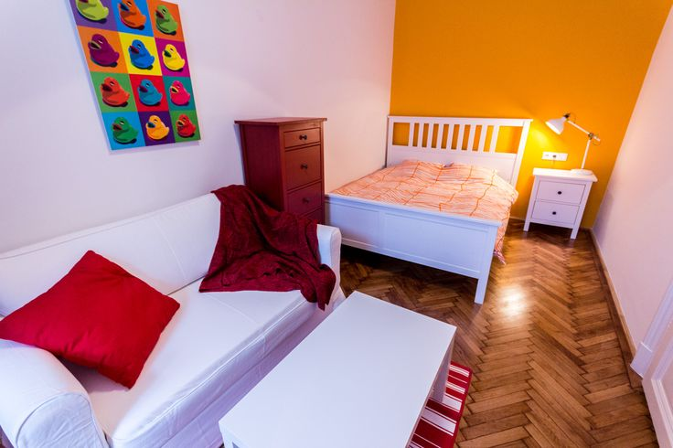 Colorful bedroom, dark yellow wall, duck picture, red comode / Budapest downtown apartment renovated and furnished by www.towerassistance.com