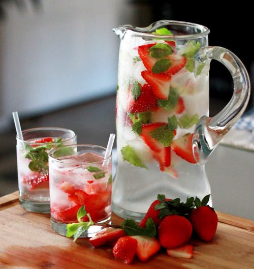 lime and strawberries in ice cold water