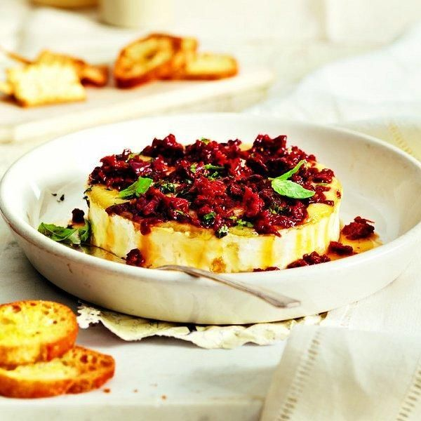 Serve this delicious Baked brie with sun-dried tomatoes and basil recipe at your next party or event. Find more appetizer ideas at Chatelaine.com.