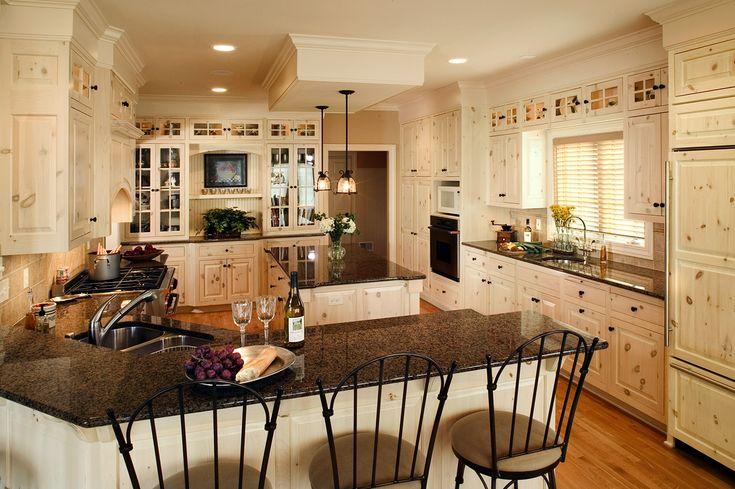 whitewash knotty pine kitchen | Whitewashed kitchen design with black hardware