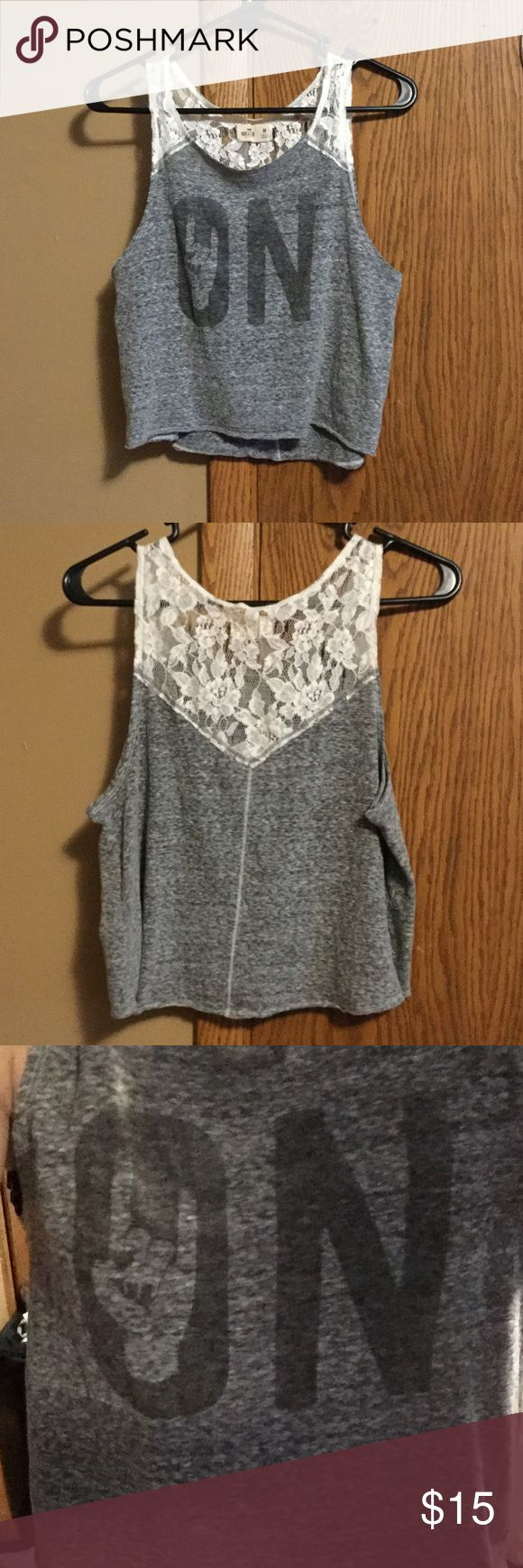 """Lace Tank Top Hollister Gray """"On"""" Tank and a rock on hand sign in the middle of the O! Super cute lace! (All my items come from smoke free home) fits more like a small Hollister Tops Tank Tops"""