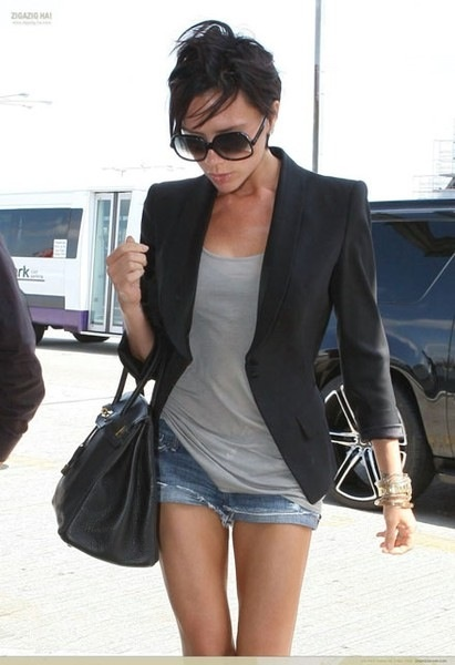 Victoria Beckam take on denim shorts -Black Blazer-Grey tank top and a Birkin from Hermes bag.