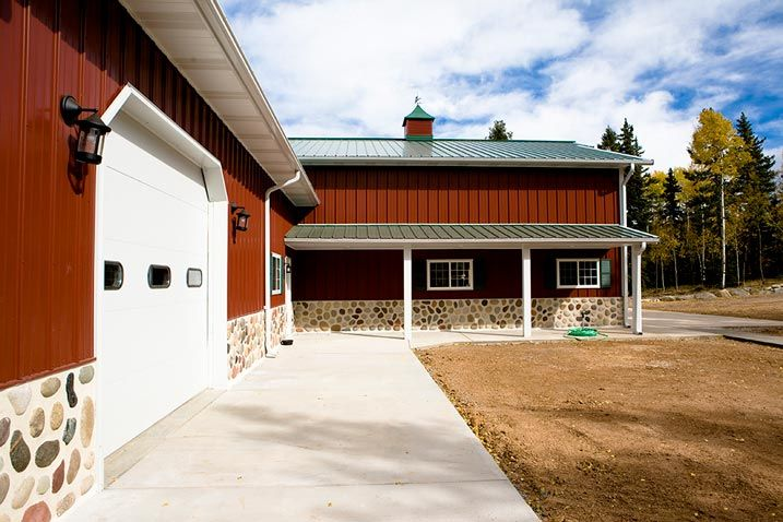 Beautiful metal building w wrap around porch stone for Metal building homes with wrap around porch