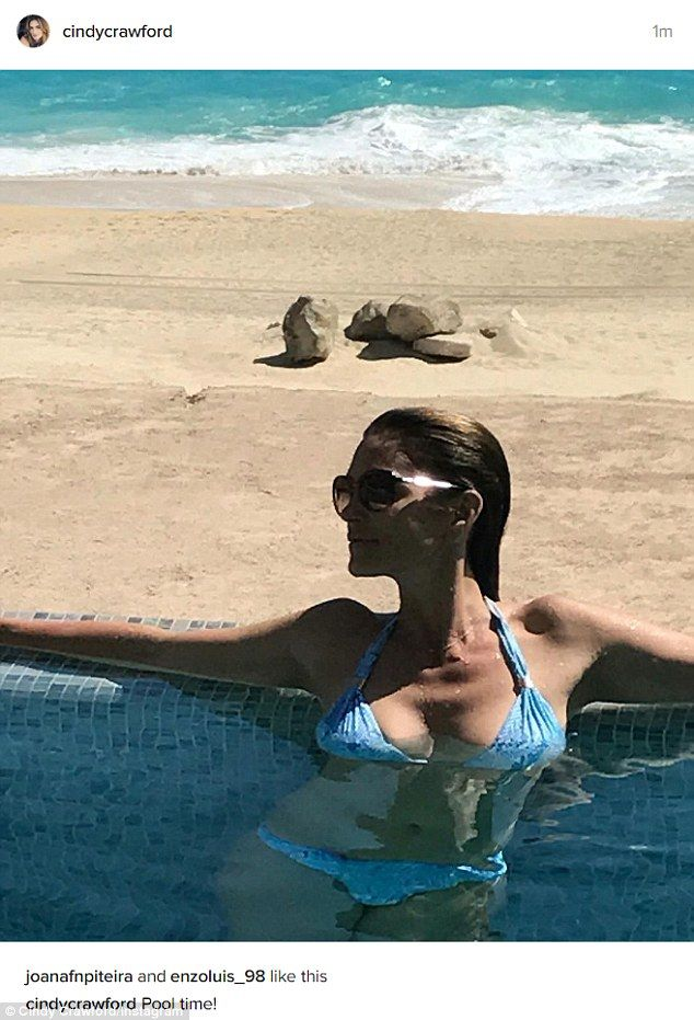 Beach babe: Even at 51, Cindy Crawford is just as hot as ever, enjoying a refreshing swim ...