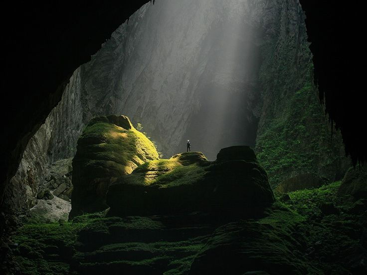 A hiker is dwarfed by the massive proportions of the world's largest cave, Vietnam's Hang Son Doong, in this National Geographic Photo of the Day.