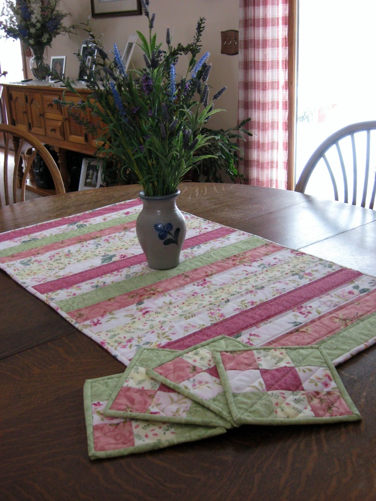 Table runner set, runner and 4 mug rugs, quilted in Spring colors. $55.00, via Etsy.