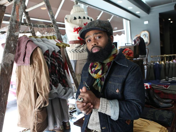 """Ouigi Theodore, a dandyish Brooklyn retailer, dreams of seeing """"guys hanging on the corner in suits."""""""