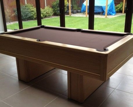 7ft Emperor UK Pool Table manufactured in European oak with wax finish and pedestal legs, with Table Tennis conversion kit. Brown leather pockets and nutmeg cloth. Shop here: http://www.snookerandpooltablecompany.com/pool-tables/uk-pool-tables/modern-bespoke-uk-pool/emperor-uk-pool-table-in-oak-with-table-tennis-conversation-kit.html