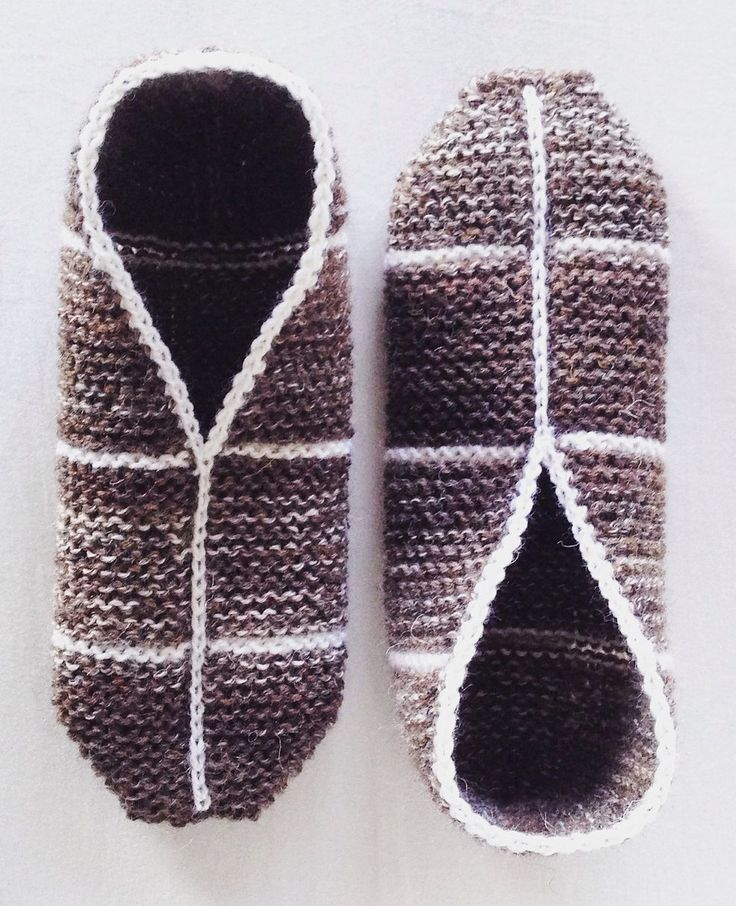 Free Knitting Pattern for Simple Garter Stitch Slippers - Hanna Leväniemi designed these easy slippers knit flat in simple garter stitch and seamed with neat crocheted finishing. Rated very easy by most Ravelrers. Great for multi-colored yarn!