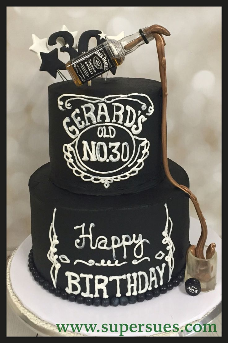 """Jack Daniels inspired cake with pulled sugar """"whiskey"""" flowing down into a molded sugar shot glass."""