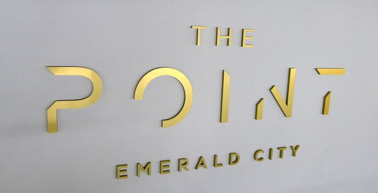 """Gold presentation centre office lobby sign in brushed gold metal substitute ½"""" thick acrylic signage flat on the wall"""