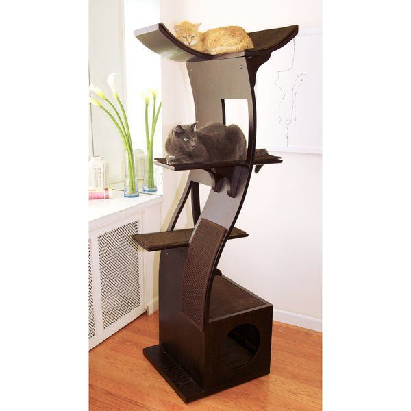 Give your cats a great place to play and rest with The Refined Feline The Lotus Cat Tree. It is great for eclectic and modern home decor. <br/><br/>The Lotus Cat Tree in Espresso by The Refined Feline is made of wood, which ensures strength and durability. It has an espresso finish, which suits most color schemes. This cat tree can accommodate five cats in its four-tiered flowering tower. It includes a condo, which provides a healthy outlet to the cats and for those time…