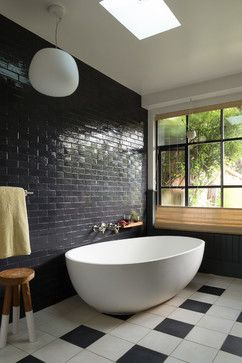 "Noe Family Home - contemporary - Bathroom - San Francisco - Alden Miller InteriorsSimple and serene, the new bathroom combines dark ""brick"" wall tile with a modern freestanding tub and a view to the backyard. Wall tile: Grove Brickworks in Naval Deep Blue, Waterworks; tub: PureScape, Aquatica; light fixture: Mochi Pendant, Fabbian"