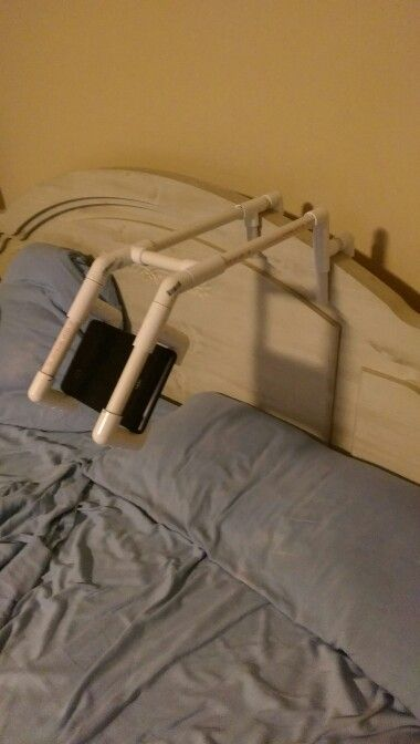 Ipad pvc holder. 90 degree for the holder. 45 degree for the angle. Figure out how far you want it out and then the way to put it in your bedhttp://pinterest.com/pin/320318592232410140/