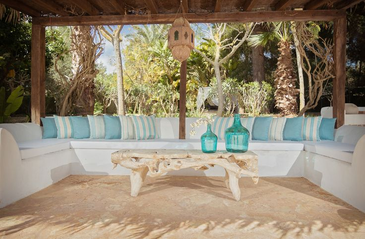 Pool area seating Ibiza style - the turquoise looks so fresh against the pure white and the driftwood table gives it that romantic feel