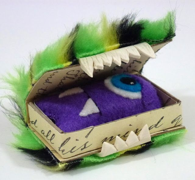 Matchbox monster...although I'm thinking on a larger scale, in a hollow book to hold a stuffed animal