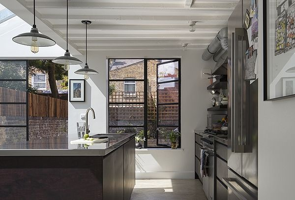 VCDesign loves this side return extension Black crittal style doors and bagged brickwork