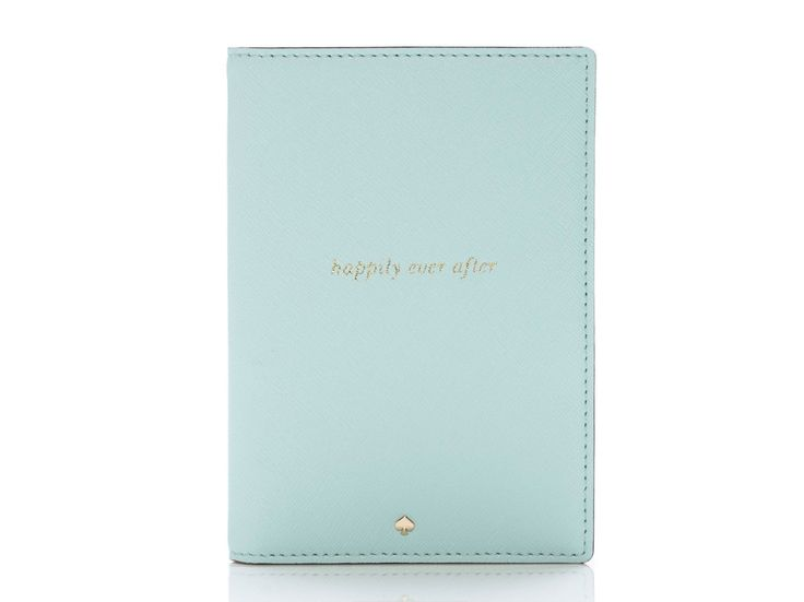 """This passport case is made specifically for newleyweds. The Wedding Belles Travel Passport Holder from Kate Spade comes embossed with the phrase """"happily ever after"""" in gold on the cover. $78"""