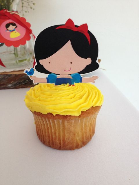 Snow White Party Cupcakes. Would be a cute way to suprise the kids for disneyland next year. a princess cupcake topper with different colored skirts.