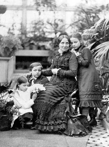 Lucy Ware Webb Hayes with her two youngest children Scott and Fanny in the White House conservatory