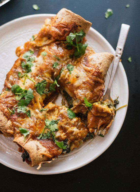 Hearty spinach artichoke enchiladas with a simple homemade red sauce! These lightened-up vegetarian enchiladas will please the whole family.