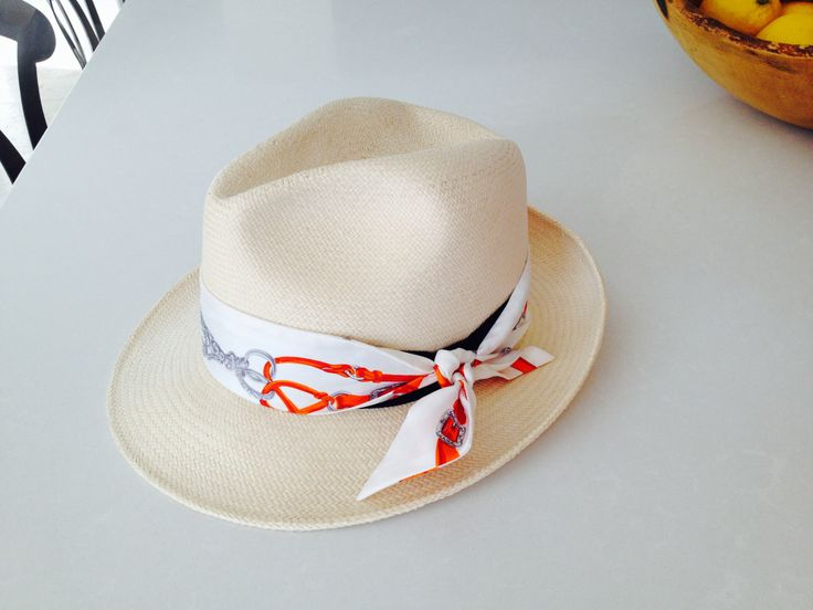 Tie a Hermes twilly on your fedora like I did here:)