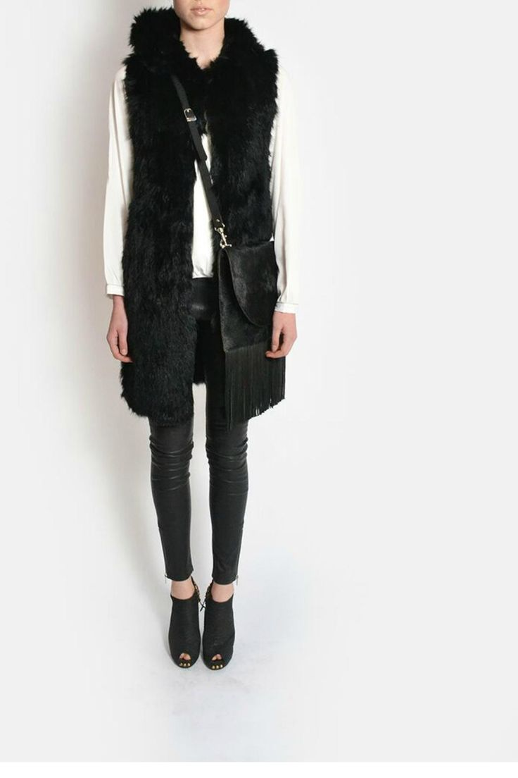 This luxurious long hooded fur vest can be worn done up or undone . Looks great with a shirt and pants. Glamourous item to have in your wardrobe and very versatile.    Sizes are Australian. AUS 4 = US 1; AUS 6 = US 2; AUS 8 = US 4; AUS 10 = US 6; AUS 12 = US 8; AUS 14 = US 10; AUS 16 = US 12; AUS 18 = US 14; AUS 20 = US 16   Long Fur Vest  by Jophiel. Clothing - Jackets, Coats & Blazers - Vests Australia