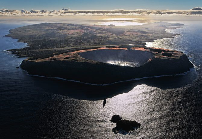 Photograph by Randy Olson  Three volcanoes, quiet now, formed Easter Island half a million years ago. It has three crater lakes but no streams; fresh water is scarce. Chile, the island's source of fuel and most food, is 2,150 miles away.