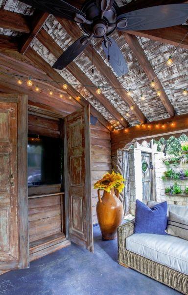 Outdoor tv behind doors