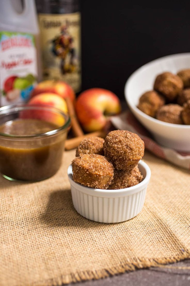 Apple Cider Donut Holes | Baked apple cider donut holes served with a hot buttered rum dipping sauce.